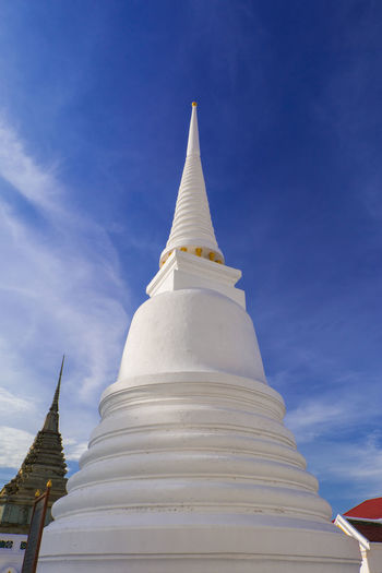 white pagoda in temple Ancient Architecture Art Bangkok Thailand. Blue Buddhism Cloud Day History Old Outdoor Pagoda Religion Respect Sky Temple Thai Architecture Thai Art Thailand White Pagoda Worship