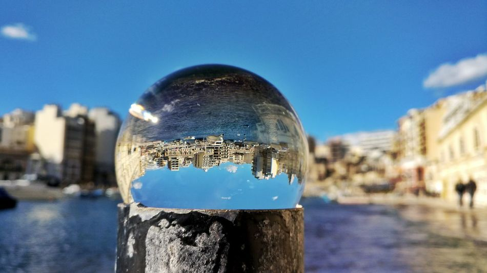 The bay through the sphere Water Reflection No People Outdoors Sphere Sphere Glass Seascape Naturelover Seascapes Seascape Mediterranean  Maltaphotography Malta Travelling Malta♥ Marina Bay Travel Photography Marina Sea Aerial View Spinola Bay Spinola Bay, Malta Harbour Harbour View Seascape Photography Travel Destinations