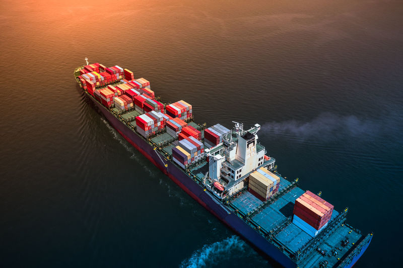 Aerial view of container ship in sea
