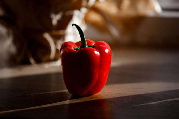 Close-up of red bell peppers on table