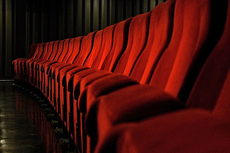 row of red velvet seats in a theater ©alexander h. schulz Auditorium Black Cinema Dark Entertainment Film Industry In A Row Indoor Indoors  Light Minimalism No People Numbers Obscure Red Color Red Velvet Seat Seat Numbers Seats Seats In A Row Show Velvet