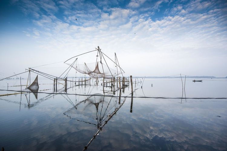 Calmness Chinese Net Environment Fishing Fishing Net India Kerala Kerala The Gods Own Country ;) Kumarakom Lake] Nature No People Outdoors Reflection Sky Still Water Tourism Tranquility Water