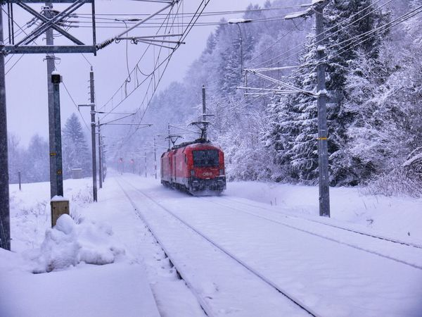 Alpine Train Cold Temperature Freezing Freezing Cold Locomotive Mountain No People Outdoors Railway Railway Station Red Red And White Red Locomotive Red Train Snow Snowing White Color Winter