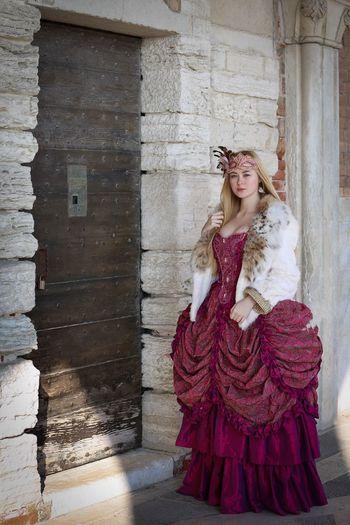 Full length of beautiful teenage girl wearing dress while standing by door