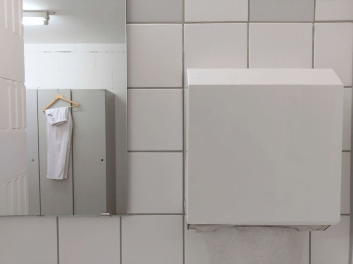 mirror and towel dispenser: locker room of nursing home for the elderly //one room Locker rooms for health care employees are sober and clean. Interior Design Minimalism Interior Hospital Hygiene Locker Locker Room Mirror Nursing Old People Retirement Home The Architect - 2018 EyeEm Awards Towl Wall Work Architecture Dispenser Healthcare And Medicine Home For The Elderly Indoors  Paper Towels Profession Tiled Trousers White