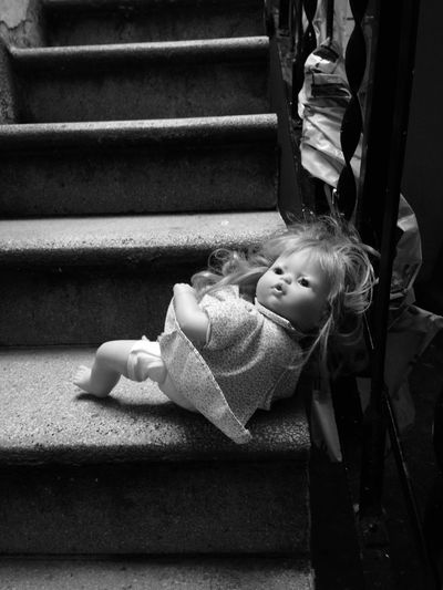 Close-Up Of Doll On Staircase