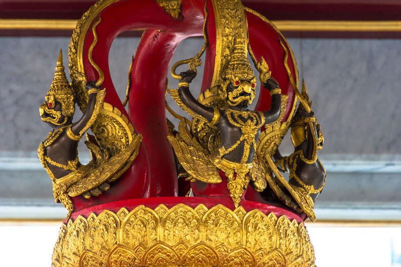 Close-up of garuda sculptures in temple
