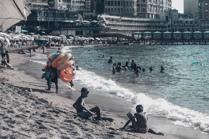 Buried Done That. Kids Relaxing The Week On EyeEm Architecture Beach Beauty In Nature Building Exterior Buried In Sand Day Floats Large Group Of People Leisure Activity Lifestyles Men Nature Outdoors People Real People Sand Sea Streetphotography Vacations Vendor Water Wave