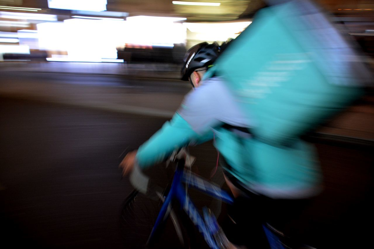 blurred motion, motion, real people, speed, transportation, men, one person, mode of transport, bicycle, protection, cycling, lifestyles, illuminated, long exposure, riding, leisure activity, land vehicle, sport, activity, full length, skill, helmet, night, headwear, indoors, city, people