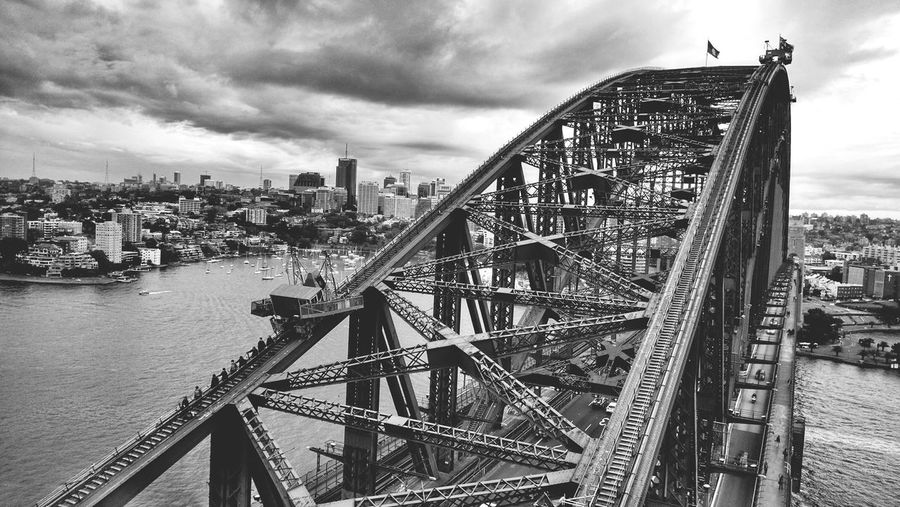 High angle view of sydney harbor bridge over river against cloudy sky