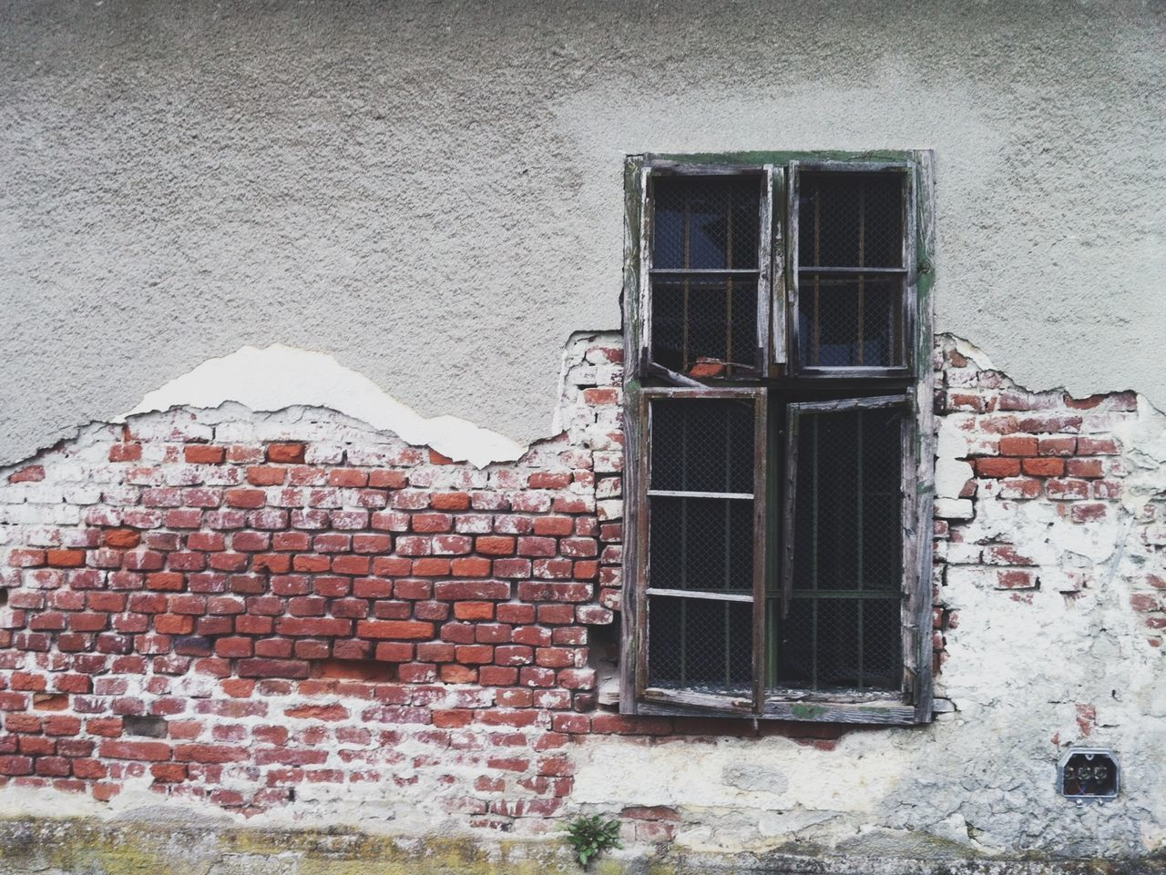 Close-up of brick wall with window