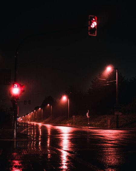 Illuminated Light Trails On Wet Street At Night