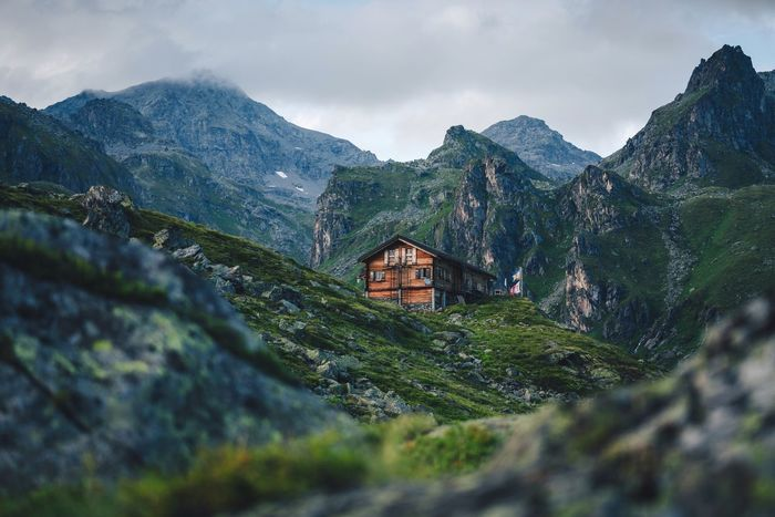 Living in a mountain hut. Valais Landscape Nature VSCO Switzerland Mountain Architecture Sky Building Built Structure Cloud - Sky Nature Building Exterior Scenics - Nature Day Beauty In Nature Landscape House Mountain Range No People Residential District Plant Environment History Outdoors