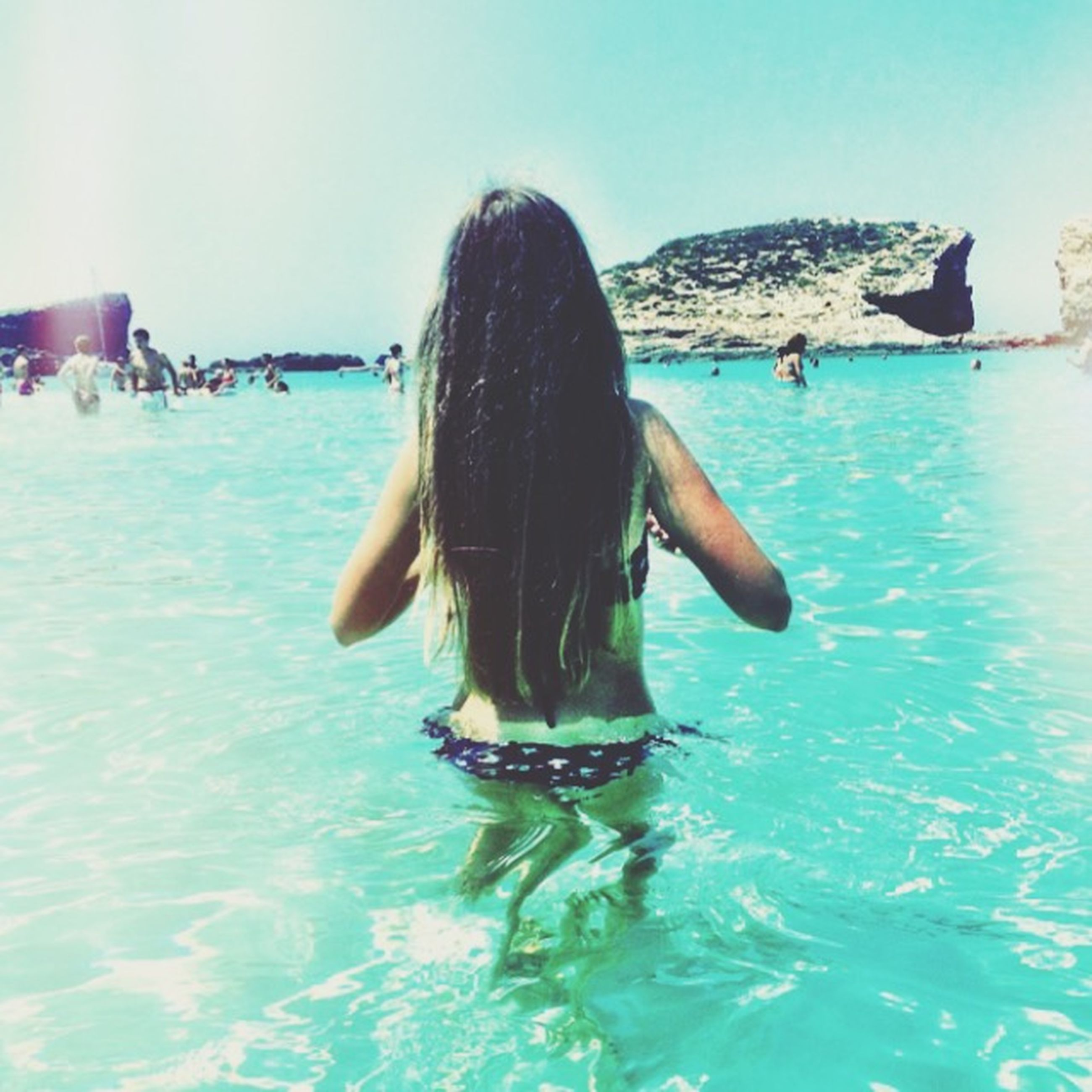 water, lifestyles, sea, leisure activity, rear view, vacations, person, young adult, young women, long hair, waterfront, blue, bikini, nautical vessel, full length, horizon over water, sitting, enjoyment