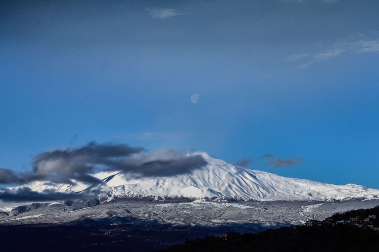 Catania Sky Scenics - Nature Mountain Beauty In Nature Cloud - Sky Snow Tranquil Scene Winter Cold Temperature Landscape Tranquility Volcano Snowcapped Mountain Non-urban Scene No People Environment Smoke - Physical Structure Nature Moon Outdoors Mountain Peak Power In Nature Volcanic Crater Pollution