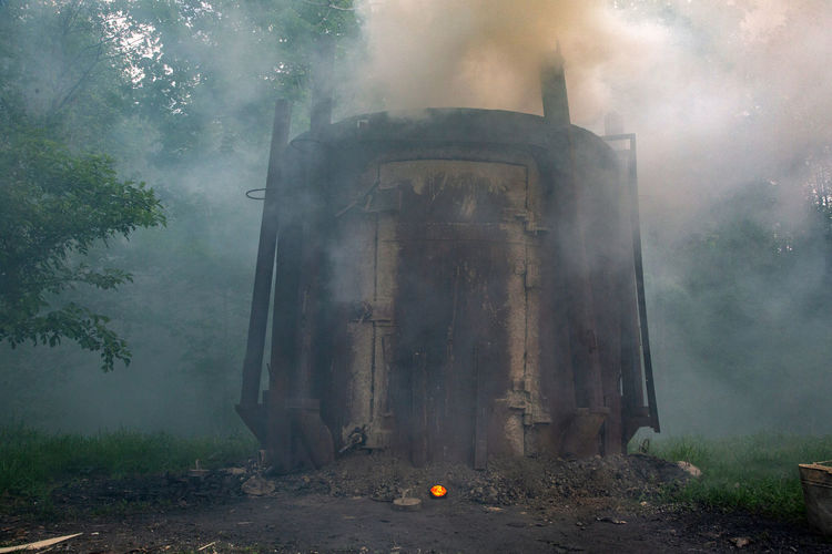 Bieszczady Mountains Smoke Abandoned Architecture Belief Built Structure Charcoal Fire Day Forest History Land Nature No People Old Outdoors Plant Retort For Wood Firing Smoke - Physical Structure The Past Tree