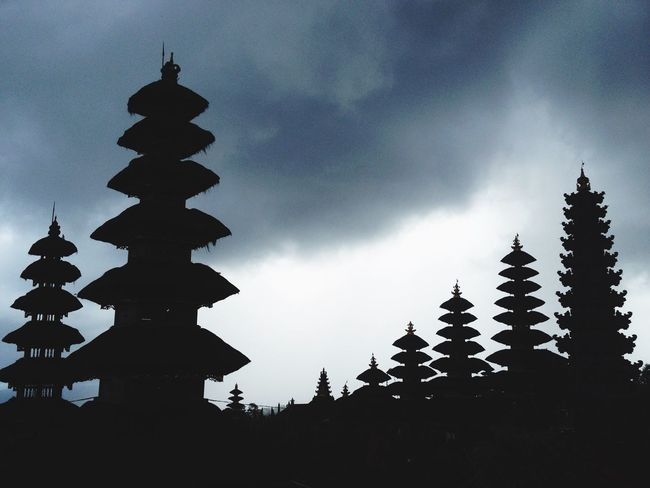 Silhouette Built Structure Architecture Sky Building Exterior Spirituality Religion Low Angle View Place Of Worship Cloud - Sky Temple - Building Outdoors Temple Pagoda Scenics Tranquility Besakih Temple Bali Traveling Miles Away