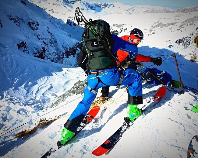 Ski lift on snow covered mountain