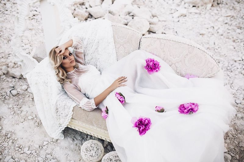 Adult One Woman Only Beauty Women Only Women Lying Down Young Adult Relaxation Females Sand Young Women Flower High Angle View One Person Pink Color Beautiful Woman Beautiful People Pampering Adults Only People