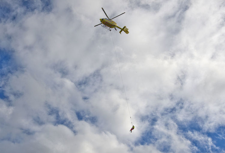 Norway Norge Rogaland Helicopter Rescue Worker Rescue Rescue Helicopter Emergency Cloud - Sky Flying Air Vehicle Motion Mid-air Low Angle View Ambulance Rescuer Transportation Day Aviation Paramedic