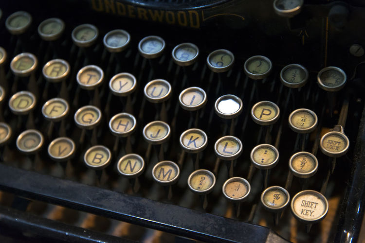 Close-up of old typewriter on table
