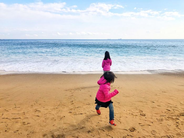 Sisters enjoying at beach