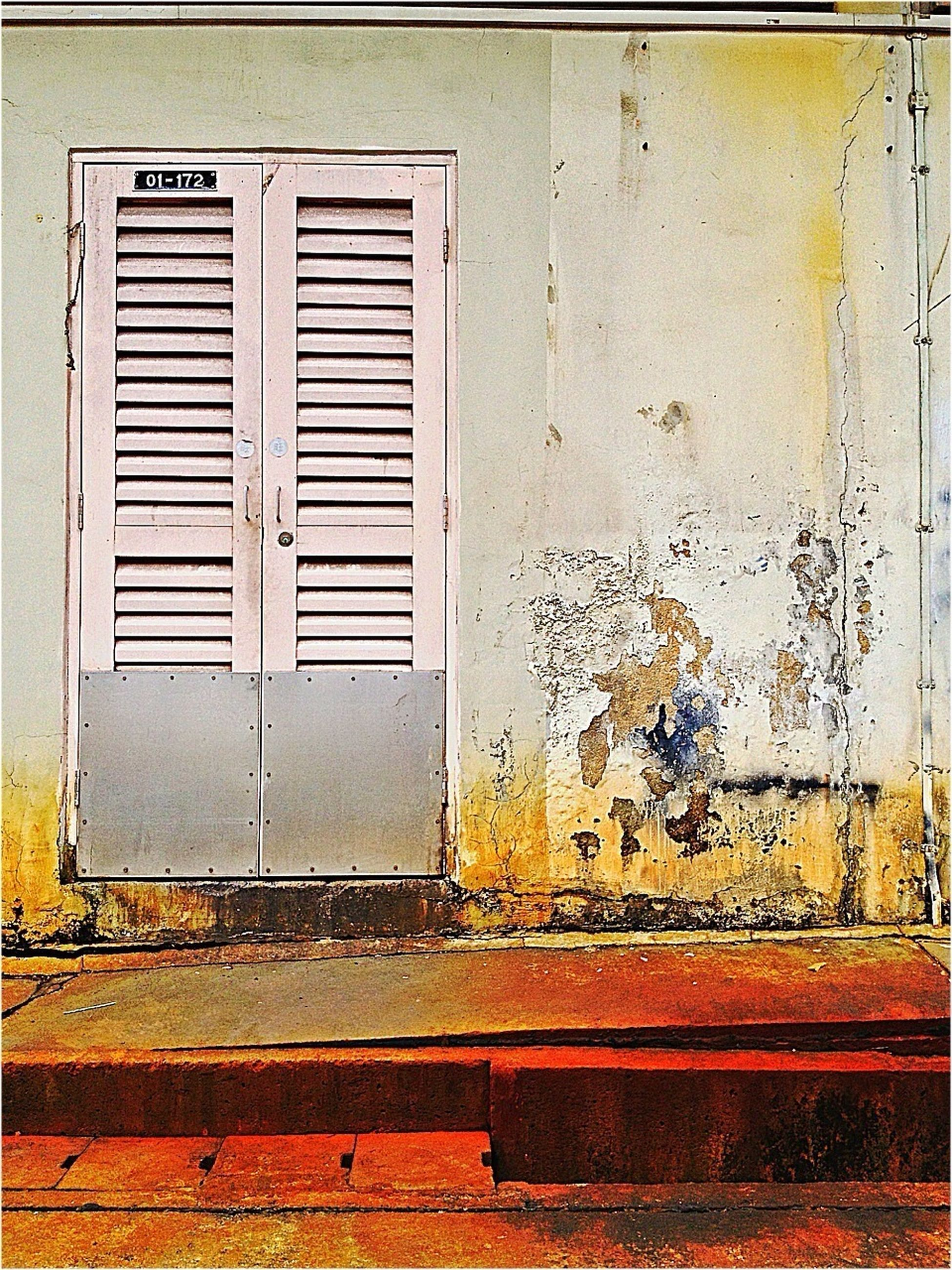 building exterior, door, built structure, architecture, closed, wall - building feature, house, shutter, window, weathered, wall, entrance, old, safety, protection, wood - material, brick wall, security, front door, closed door
