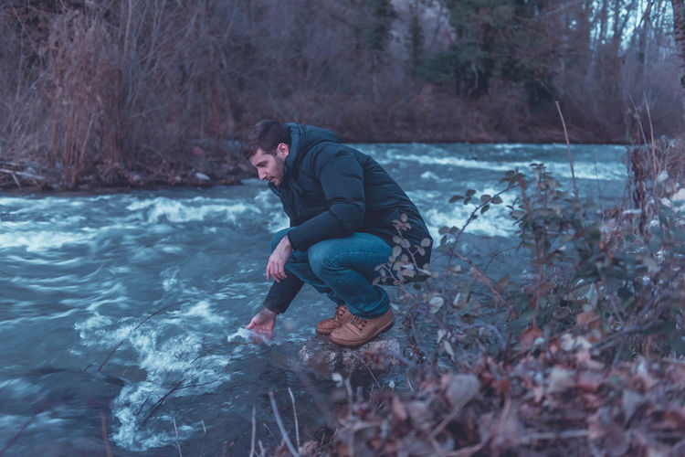Full length of man in water