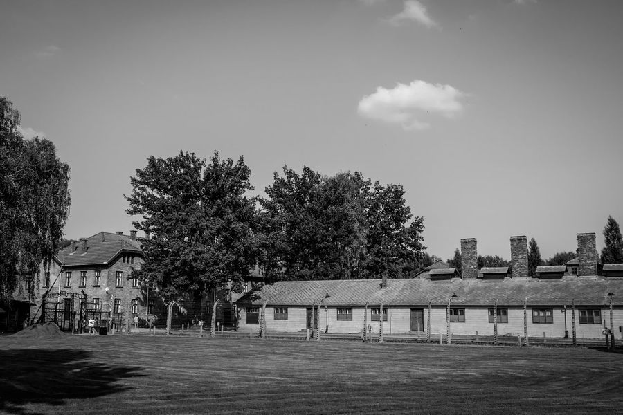 Auschwitz Auschwitz  Tree Sky Plant Nature Architecture Built Structure Day Park Outdoors Building Exterior Park - Man Made Space No People Playground Absence Cloud - Sky Empty City Sunlight Building Outdoor Play Equipment
