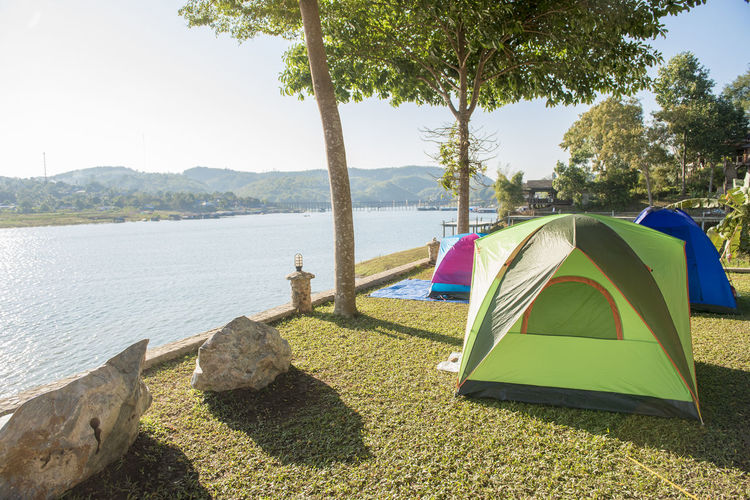 Scenic view of campsite at waterfront