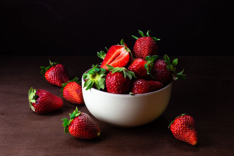 Fresh strawberries in ceramic bowl on dark wooden background. Selective focus. Food And Drink Food Freshness Red Indoors  Still Life No People Strawberry Strawberries Fruit Fruits Fresh Healthy Eating Vehetable Natural Raw Vitamin Raw Food Tasty Breakfast Ripe Juicy Sweet Berry Delicious Nutrition Background Rustic Dessert Freshness Eating Organic Close-up Diet Ingredient Vegan Snack Apperitive Pattern Dark Wooden Table Brown Texture Textured  Bowl Plate Ceramic Berry Fruit Wellbeing Black Background Studio Shot Group Of Objects Large Group Of Objects Healthy Lifestyle