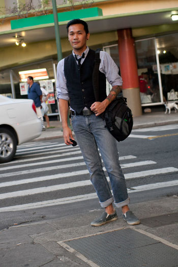 Full length of young man walking in city