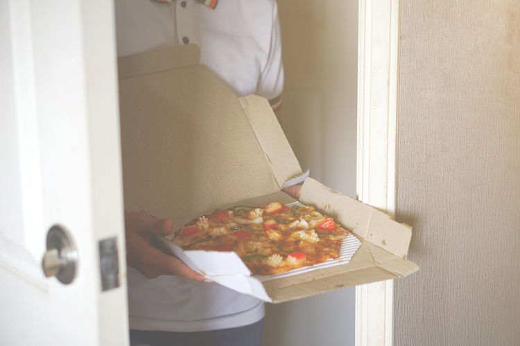 Have time to eat pizza. Box Box - Container Cardboard Cardboard Box Casual Clothing Container Domestic Room Food Food And Drink Freshness Holding Home Interior Indoors  Lifestyles One Person Pizza Pizza Box Real People Standing Women