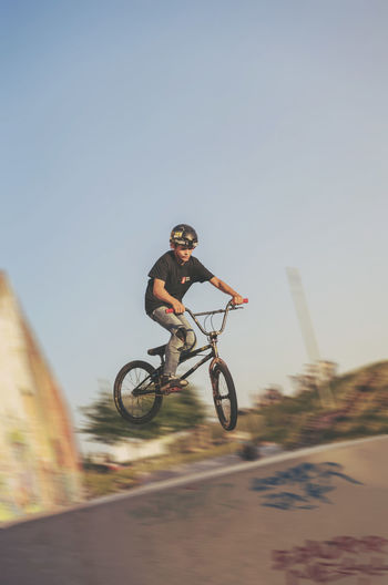 Low angle view of person riding bicycle