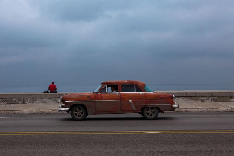 Man Driving Car On Road At Seaside