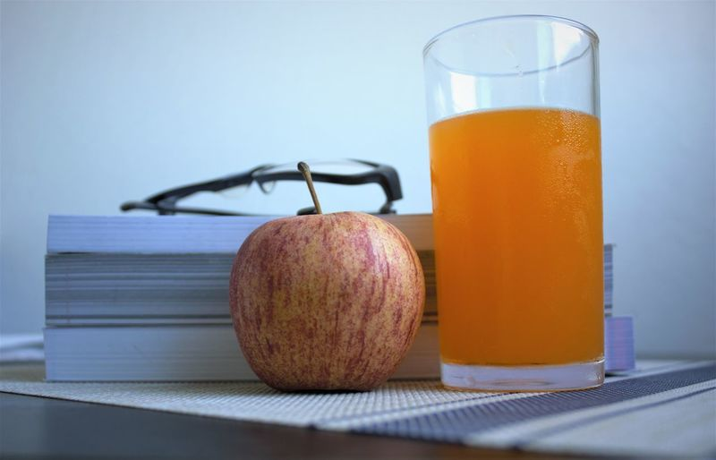 still life drink paper Food And Drink Healthy Eating Food Refreshment Drink Wellbeing Freshness Fruit Household Equipment Indoors  Glass Still Life Drinking Glass No People Healthy Lifestyle Close-up Apple - Fruit Table Orange Juice  Dieting