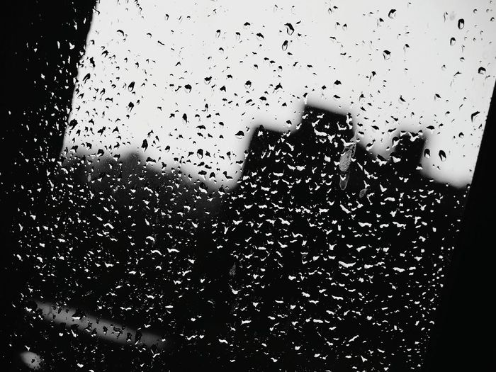 Some rain on window Backgrounds Close-up Day Drop Full Frame Nature No People Outdoors Rain Sky Water Wet Window