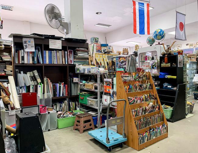 Multi colored books in shelf