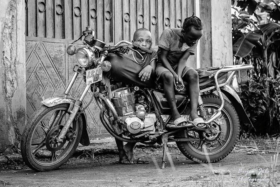 Here in sub saharan Africa a bike represent a hope for many families to have a meal as bikes are used for public transportation Outdoors People African Beauty Africa Discover The World Discover Africa Portraits First Eyeem Photo Street Photography Snapshots Of Life