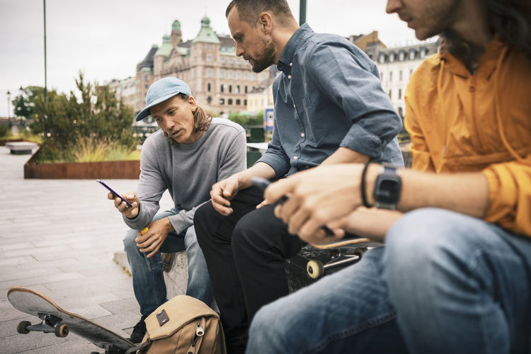 People sitting on mobile phone