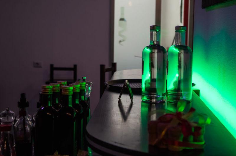 Vodka bottles on table at restaurant