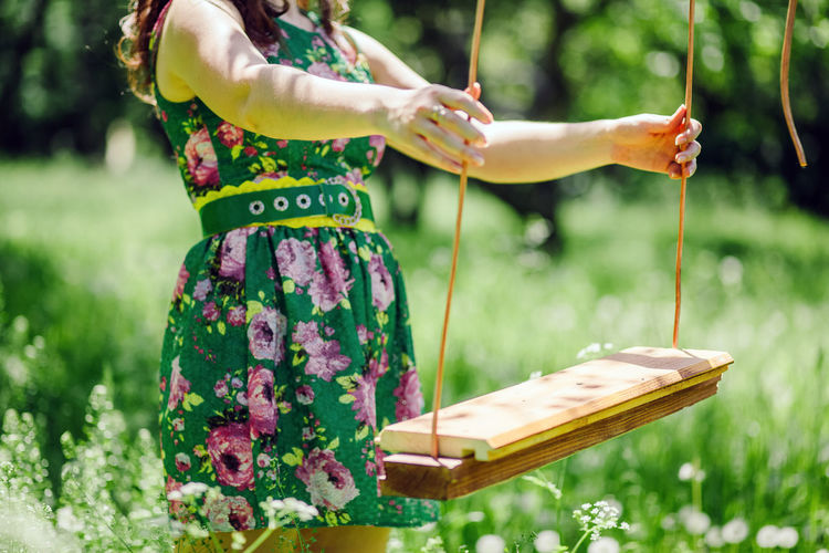 woman ride on swing. Summer time leisure and relaxation. One Person Plant Nature Grass Real People Casual Clothing Human Body Part Human Hand Leisure Activity Swing Swinging Summer Springtime Lifestyles Woman Female Happiness