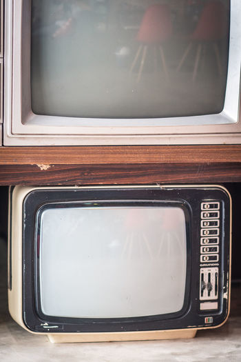 Close-up of old vintage television sets