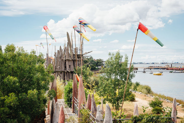 Flag Wooden Castle Wood - Material Old Harbour Harbor Nautical Vessel Boat Landscape Seascape Sea Windsock Water Plant Sky Nature Cloud - Sky Tree Day Architecture River No People Built Structure Transportation Outdoors Multi Colored Growth Scenics - Nature Building Exterior