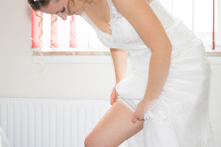Final preparations - the garter Garter Final Preparations Bride Bridetobe Bride Dress Bridedress Dressing Up Dressed Up Wedding Wedding Photography Wedding Day Weddings Around The World WeddingScenes Marriage  Married Wife FutureWife Blonde Blonde Hair Softskin Soft Skin 43 Golden Moments Portrait Of A Woman Portrait Germany Be. Ready.