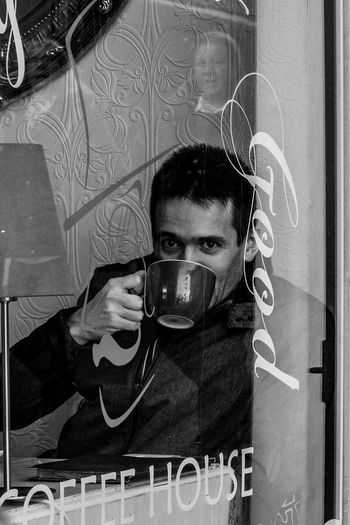 Coffee drinker captured in Bury St Edmunds, Suffolk, UK Coffee Time Coffee Cup Coffee Break One Person Real People Lifestyles Looking At Camera Reflection Coffee Mug Drinking Coffee Coffee Shop Coffee Shop Images Black And White Black And White Collection  Black And White Portrait Streetphotography Streetphoto_bw Coffee Drinker