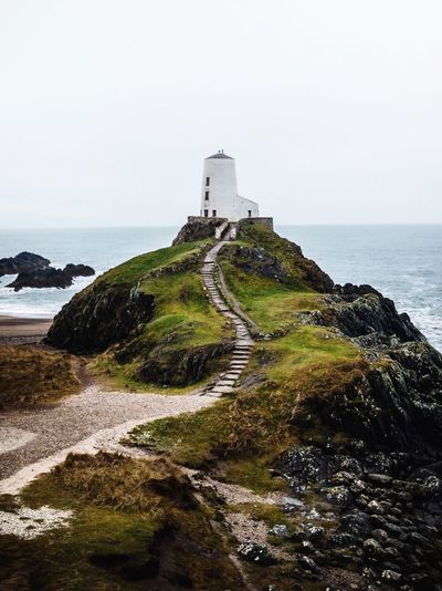 Lighthouse Landscape Travel Water Sea Built Structure Architecture Sky Building Exterior Land Beach Lighthouse Nature Outdoors Scenics - Nature No People