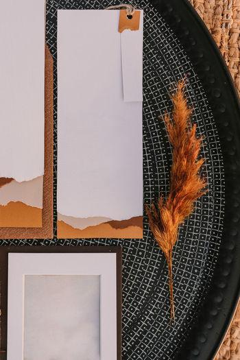 Close-up of orange leaf on table