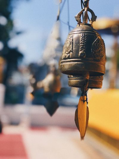 Close-up of bells hanging in temple