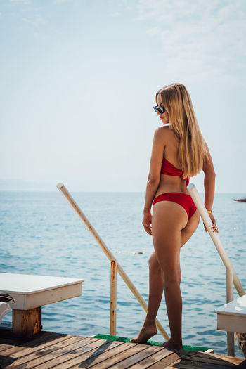 Water Sea Young Adult One Person Leisure Activity Young Women Real People Swimwear Hair Blond Hair Lifestyles Clothing Bikini Beautiful Woman Sky Adult Hairstyle Women Fashion Horizon Over Water